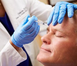 man getting botox treatment